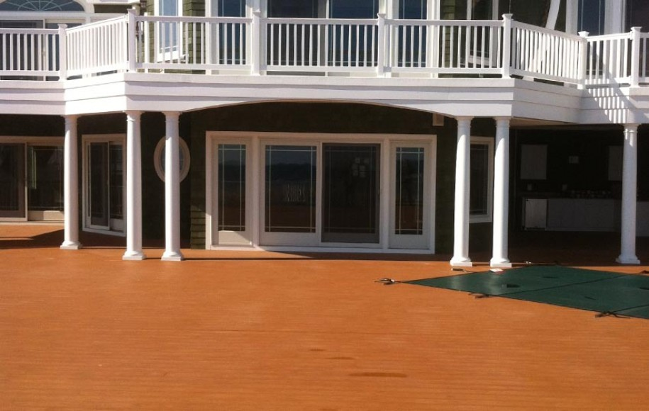 brown decking with 2nd story white vinyl deck and railing
