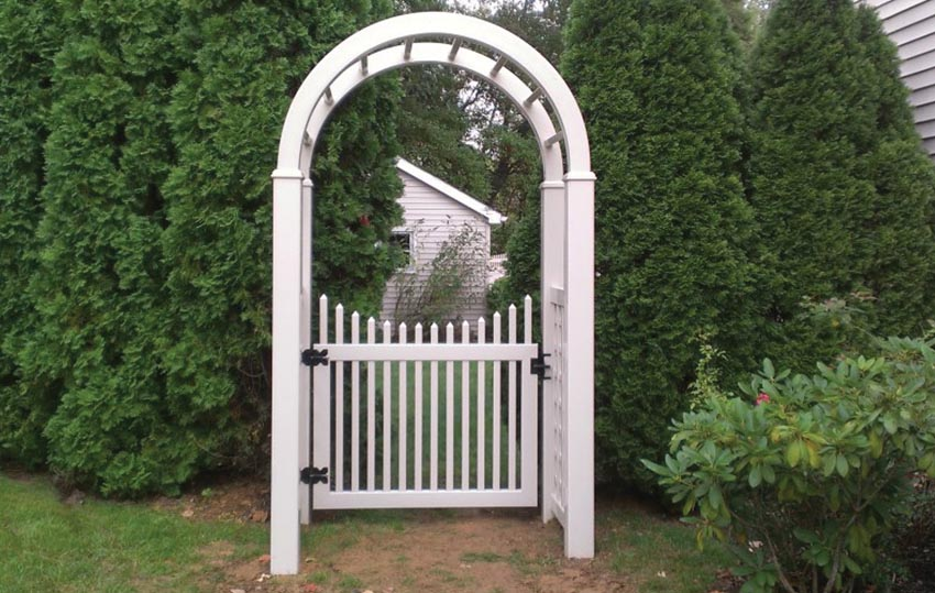 white arbor and gate