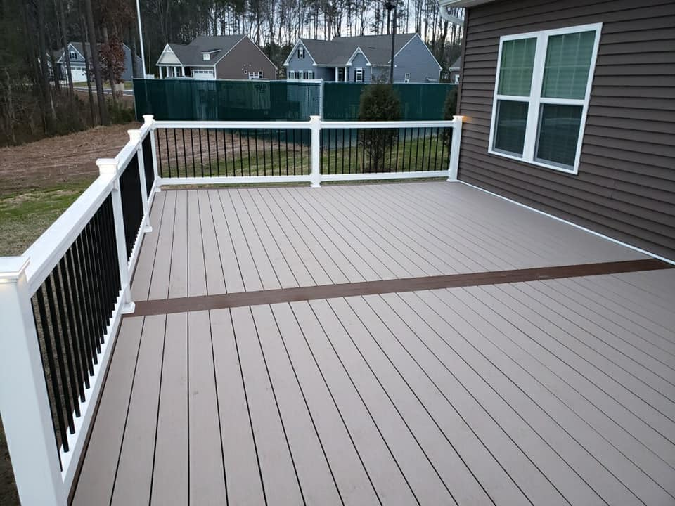 exterior deck with white posts black railing