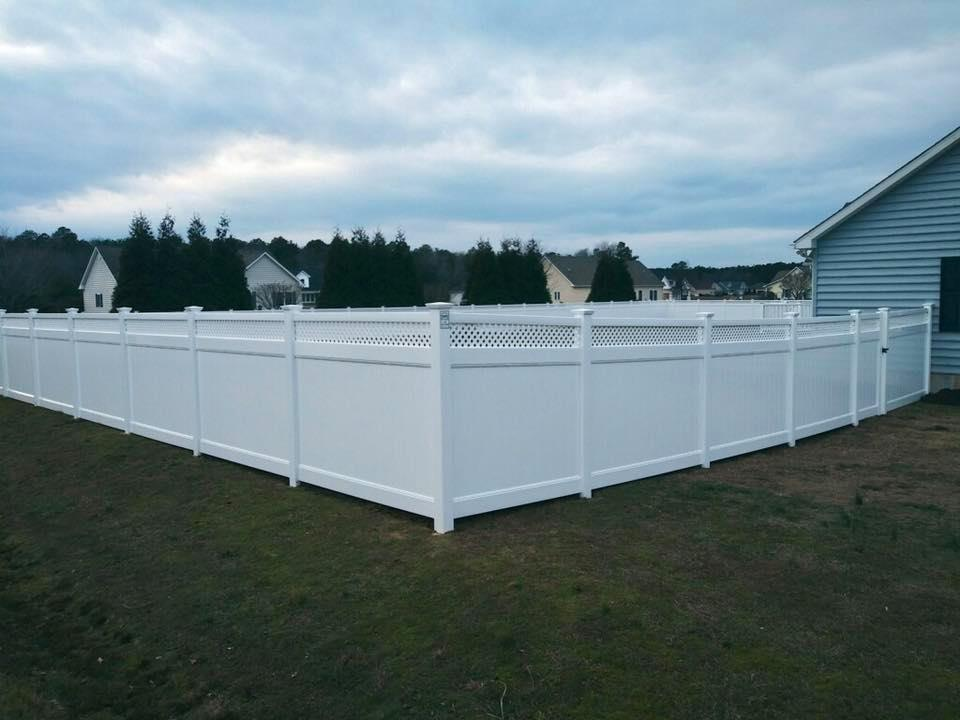 backyard with white vinyl privacy fence