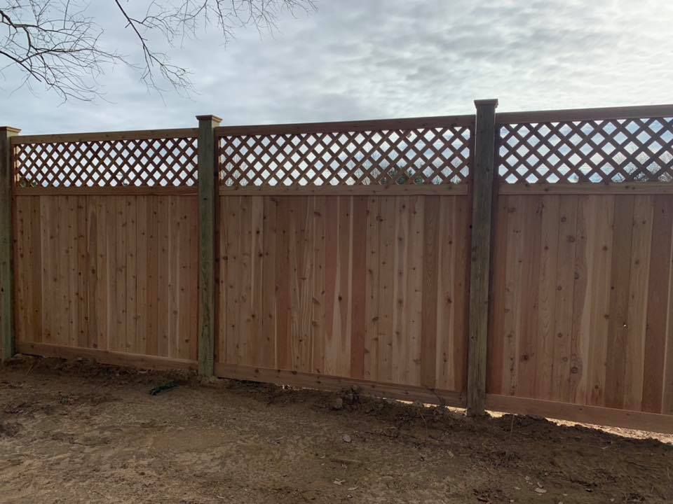 solid cedar wood fence with lattice work at top