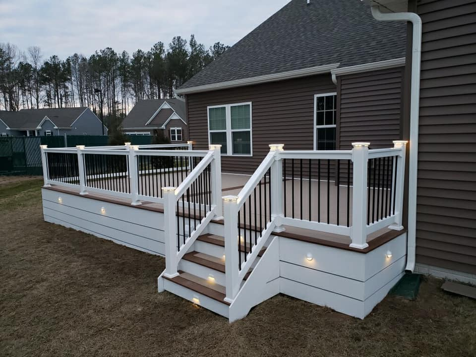 deck with white railing backyard of house