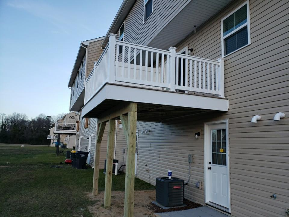 2nd story elevated deck with white railing