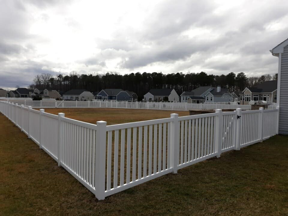 white picket fence in a Sussex county backyard