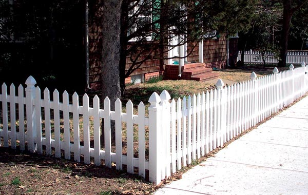 white picket fence short around front yard of home